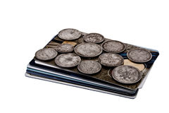 Coins and credit cards. Old silver coins and credit cards Stock Photography