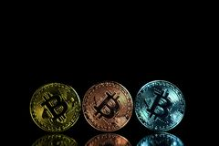 Coins of cryptocurrency or Bitcoin lying over laptop keyboard, stock photography