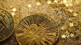 Coins of Cryptocurrency Fall on Glittering Stars Macro stock footage