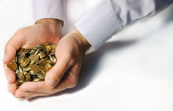 Coins in cupped hands. Isolated Stock Image
