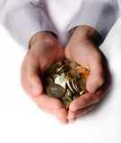 Coins in cupped hands Stock Images