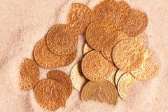 coins den guld- gammala sanden Fotografering för Bildbyråer