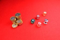 Coins and dices stock images
