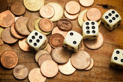 Coins and dices Royalty Free Stock Photography