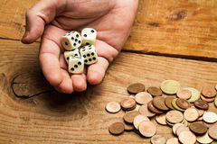 Coins and dices Stock Photography