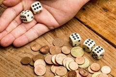 Coins and dices Stock Photos