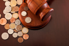 Coins. From different countries and gavel Royalty Free Stock Photos