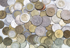 Coins of different countries on Royalty Free Stock Photo