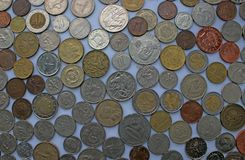 Coins of different currencies laying next to eachother - Euro, Bath, dollar, pound and more royalty free stock photos