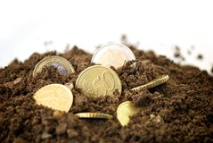 Coins in dirt concept. Different euro's in dirt concept Stock Photo