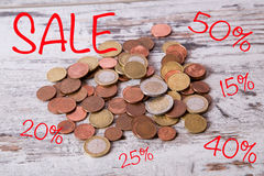 Coins and discounts Stock Photography