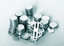 Coins and dollar. A photo of coins and dollar sign Royalty Free Stock Photography