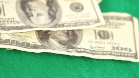 Coins and dollar spinning on a gambling table. Coins and dollar spinning on a green gambling table stock video