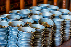 Coins in donation bowls for a buddhist temple Stock Photo