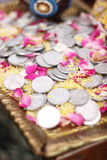 Coins Dowry. On yellow rice Stock Image