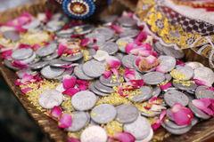 Coins Dowry. On yellow rice Stock Photos
