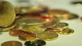 Coins dropping. Close up shot stock footage