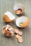 Coins in the egg. Business concept Royalty Free Stock Images