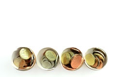 Coins in eggs Royalty Free Stock Photos