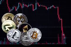 Coins etherium, bitcoin, dash, litecoin, ripple, zcash against the background of falling exchange chart stock images
