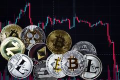 Coins etherium, bitcoin, dash, litecoin, ripple, zcash against the background of falling exchange chart royalty free stock photos