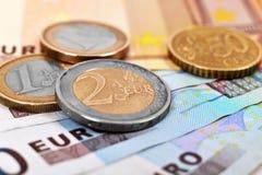 Coins and euro banknotes Stock Photos