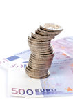 Coins and euro bills Stock Image