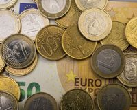 Coins euro cents are on a paper bill of fifty euros.  Euro money. Currency of the European Union Royalty Free Stock Photography