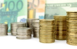 Coins, euro and dollar banknotes Stock Photos