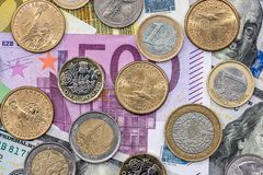 Coins are on euro and dollar. Denominations royalty free stock images