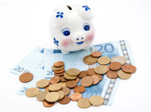 Coins and euro with piggy bank Royalty Free Stock Image