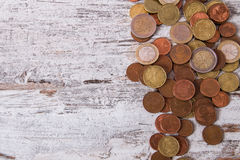 Coins. Euro coins on wooden table Royalty Free Stock Photos