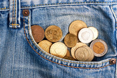 Coins in faded jeans. Lack of means of subsistence Royalty Free Stock Images