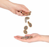 Coins fall from hand to hand Royalty Free Stock Images