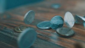 Coins Fall in slow motion. High quality dollar coins falling.  stock video footage