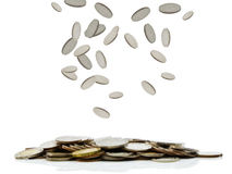 Coins falling Royalty Free Stock Images