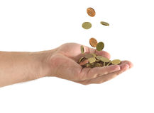 Coins falling in a hand. In a white background Royalty Free Stock Images