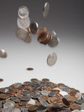 Coins Falling on Pile Royalty Free Stock Photo
