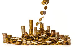 Coins falling into a pile Royalty Free Stock Image