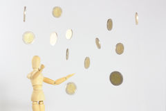 Coins falling from the sky. European money coins falling or raining down from the sky with a neutral background. The hope of many people Royalty Free Stock Images