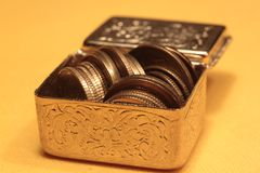 Coins. A few coins in golden box Stock Images