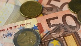 Coins And Fifty Bill. Extreme Close Up Many Euro Coins And Fifty Euro Bill. Close Up. Business Concept stock footage