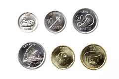 Coins from Fiji. On a white background royalty free stock image