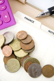 Coins on finance page Royalty Free Stock Images