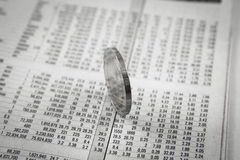 Coins on financial report Stock Photos