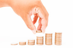 Coins in finger and row stacks them Stock Image