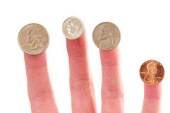 Coins on finger tips Stock Images
