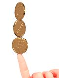 Coins and fingers. Gold coins with euro, dollar and pound symbols. 3D CG Royalty Free Stock Image