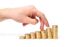 Coins and fingers Royalty Free Stock Photography