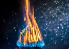 Coins on fire. The concept of high prices for natural gas.